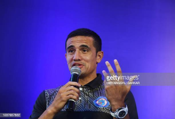 Australian player Tim Cahill of the Jamshedpur FC of the Indian Super League gestures as he speaks during an event in Kolkata on September 22, 2018....