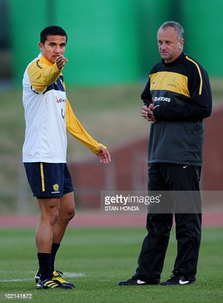 Australian player Tim Cahill talks with assistant coach Graham Arnold during a team training session at Ruimsig Stadium in Roodepoort on June 16 2010...