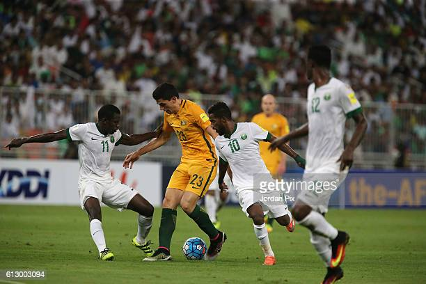 Australian player Tomas Rogic competes with Saudi Abdulamlek Al Khaibri and Nawaf Alabid during the match between Saudi Arabia and Australia for the...