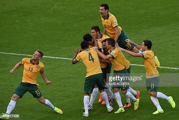Australian players celebrate a goal opn a penalty kick during a Group B football match between Australia and the Netherlands at the BeiraRio Stadium...