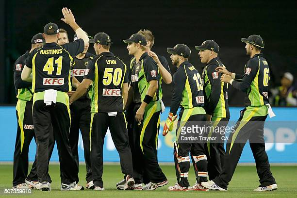 Australian players celebrate a wicket taken by debutante Andrew Tye during the International Twenty20 match between Australia and India at Melbourne...