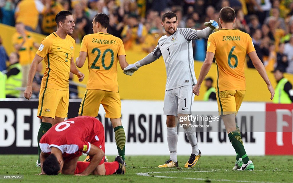 Australian players celebrate after Australia defeated Syria in their 2018 World Cup football qualifying match played in Sydney on October 10, 2017. /