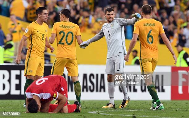 Australian players celebrate after Australia defeated Syria in their 2018 World Cup football qualifying match played in Sydney on October 10 2017 /...