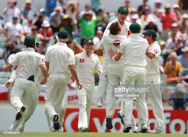 Australian players celebrate after Ryan Harris took the final wicket to dismiss Engalnd during day four of the Third Ashes Test match between...
