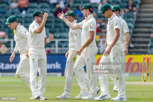 Australian players celebrate after the dismissal of Keshav Maharaj during day 2 of the 4th Sunfoil Test match between South Africa and Australia at...