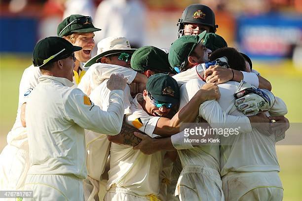 Australian players celebrate after winning the game during day 5 of the third test match between South Africa and Australia at Sahara Park Newlands...