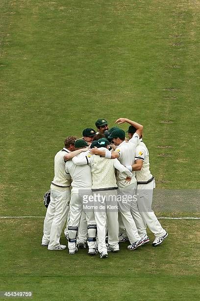 Australian players celebrate after winning the game during day five of Second Ashes Test Match between Australia and England at Adelaide Oval on...