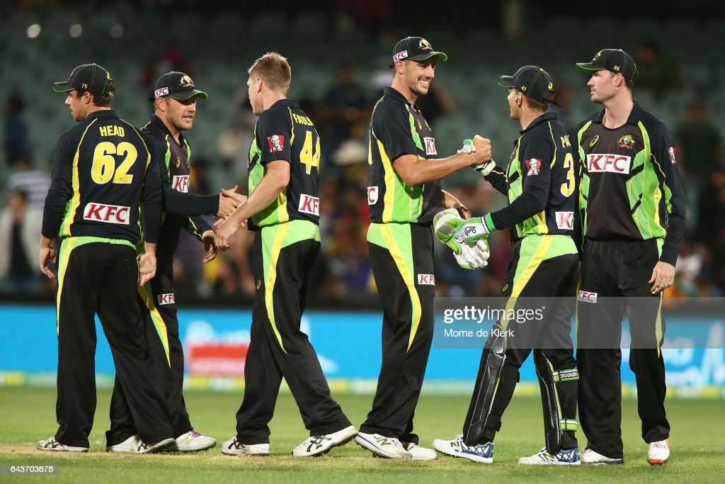 Australian players celebrate after winning the International Twenty20 match between Australia and Sri Lanka at Adelaide Oval on February 22, 2017 in Adelaide, Australia.