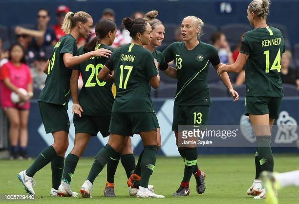Australian players celebrate following thier first goal against Brazil during their Tournament of Nations match at Children's Mercy Park on July 26...