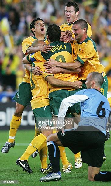 Australian players celebrate Marco Bresciano's goal during the second leg of the 2006 FIFA World Cup qualifying match between Australia and Uruguay...