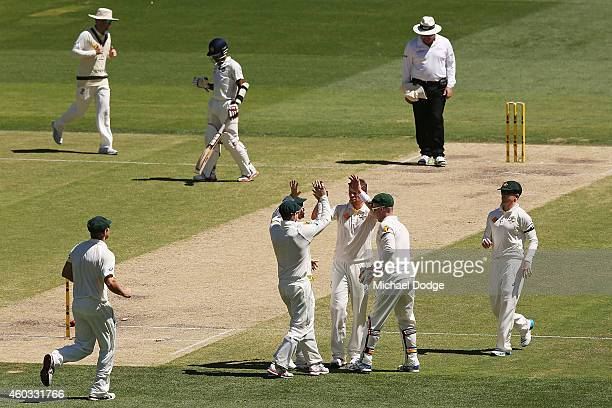 Australian players celebrate Peter Siddle's dismissal of Karn Sharma of India during day four of the First Test match between Australia and India at...