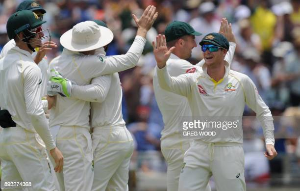 Australian players celebrate the dismissal of England's Dawid Malan on day two of the third Ashes cricket Test match in Perth on December 15 2017 /...