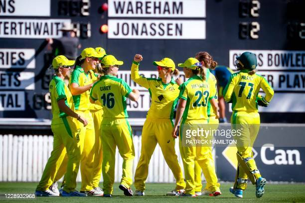 Australian players celebrate the dismissal of New Zealand's Amy Satterthwaite during the third one-day international cricket match between Australia...