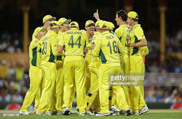 Australian players celebrate the wicket of Ajinkya Rahane of India during the 2015 Cricket World Cup Semi Final match between Australia and India at...