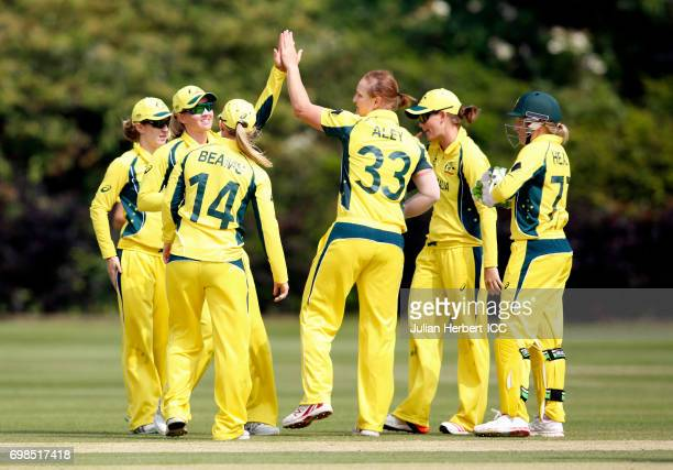 Australian players celebrate the wicket of Chloe Tryon of South Africa during the ICC Women's World Cup warm up match between Australia and South...