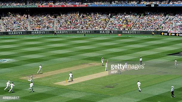 Australian players celebrate the wicket of Michael Carberry off the bowling of Shane Watson on the first day of the fourth Ashes cricket Test match...