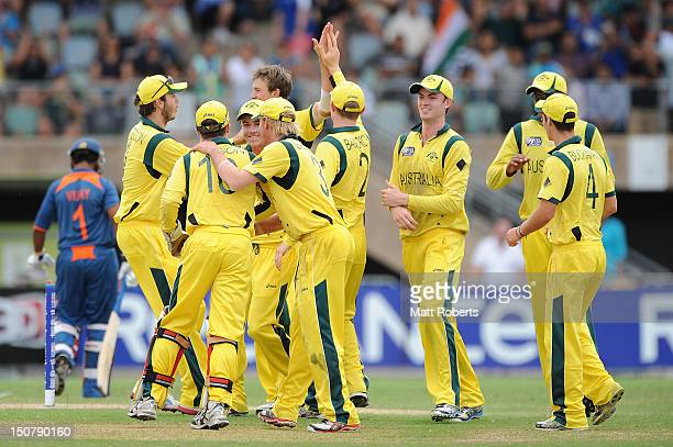 Australian players celebrate the wicket of Vijay Zol of India during the 2012 ICC U19 Cricket World Cup Final between Australia and India at Tony...