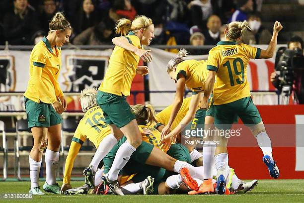 Australian players celebrate their first goal scored by Lisa De Vanna during the AFC Women's Olympic Final Qualification Round match between...