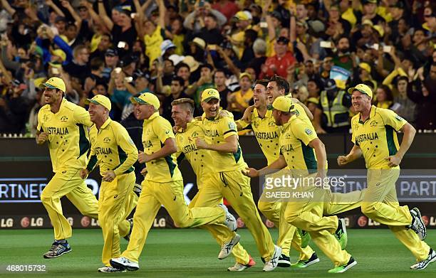 Australian players celebrate their victory against New Zealand in the 2015 Cricket World Cup final in Melbourne on March 29, 2015. AFP PHOTO / SAEED...