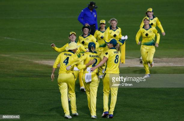 Australian players celebrate victory during the Women's One Day International match between Australia and England on October 26 2017 in Coffs Harbour...