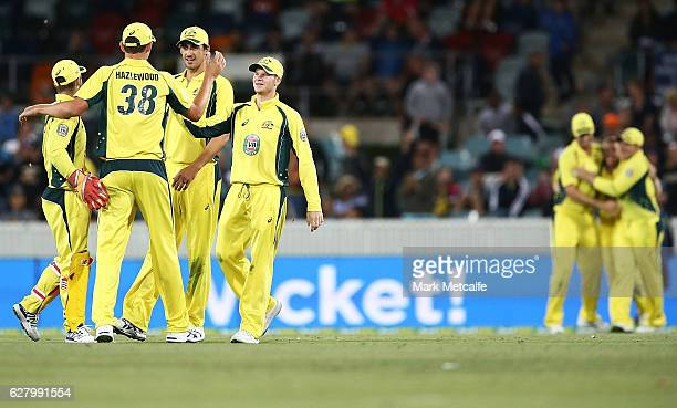 Australian players celebrate victory in game two of the One Day International series between Australia and New Zealand at Manuka Oval on December 6...
