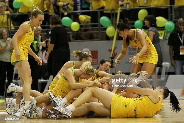 Australian players celebrate victory over New Zealand during the final match between Australia and New Zealand on day eight of the 2011 World Netball...
