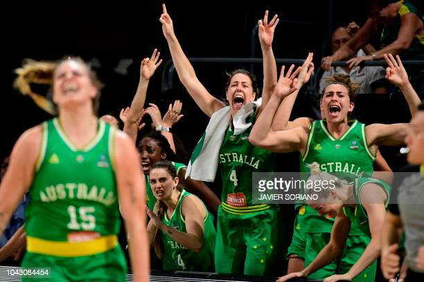 Australian players celebrate winning a point during the FIBA 2018 Women's Basketball World Cup semifinal match between Spain and Australia at the...