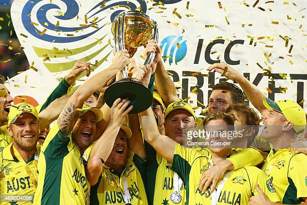 Australian players celebrate winning the 2015 ICC Cricket World Cup final match between Australia and New Zealand at Melbourne Cricket Ground on...