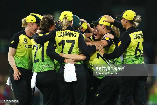 Australian players celebrate winning the ICC Women's T20 Cricket World Cup Semi Final match between Australia and South Africa at Sydney Cricket...