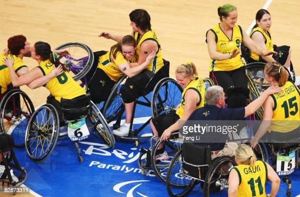 Australian players celebrate winningthe bronze medal Wheelchair Basketball match between Australia and Japan at the National Indoor Stadium during...