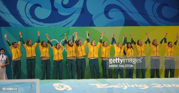 Australian players celebrate with their bronze medals after defeating Hungary in a penalty shootout during the women's bronze medal match at the 2008...