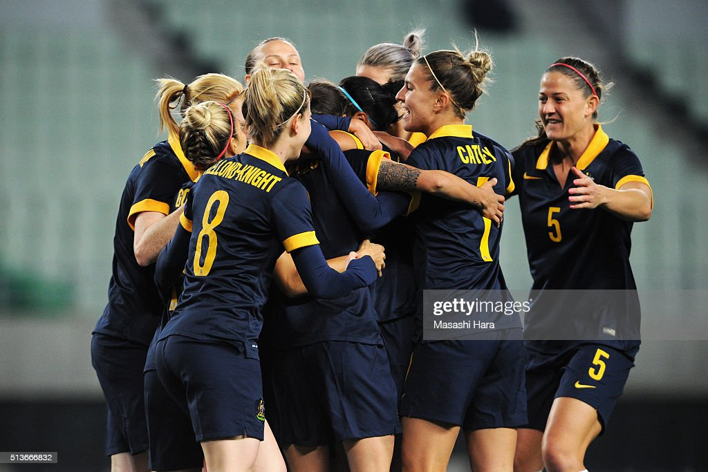 Australian players celerbate their team's first goal by Kyah Simon (obscured) during the AFC Women's Olympic Final Qualification Round match between South Korea and Australia at Yanmar Stadium Nagai on March 4, 2016 in Osaka, Japan.