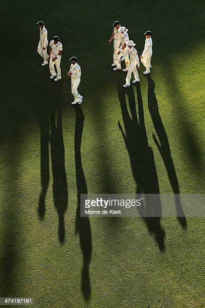 Australian players come from the field at the end of play during day three of the Second Test match between South Africa and Australia at AXXESS St...