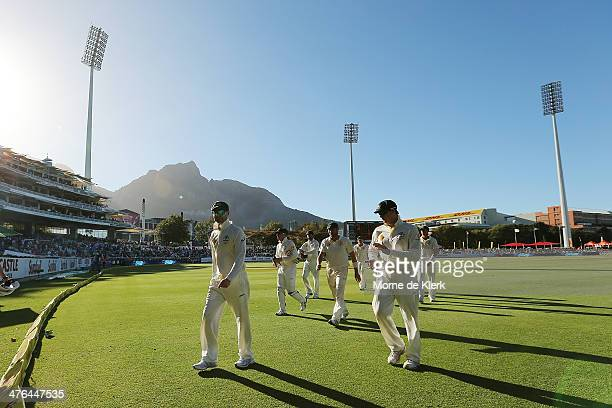 Australian players come from the field at the end of the South African innings led by their captain Michael Clarke during day 3 of the third test...