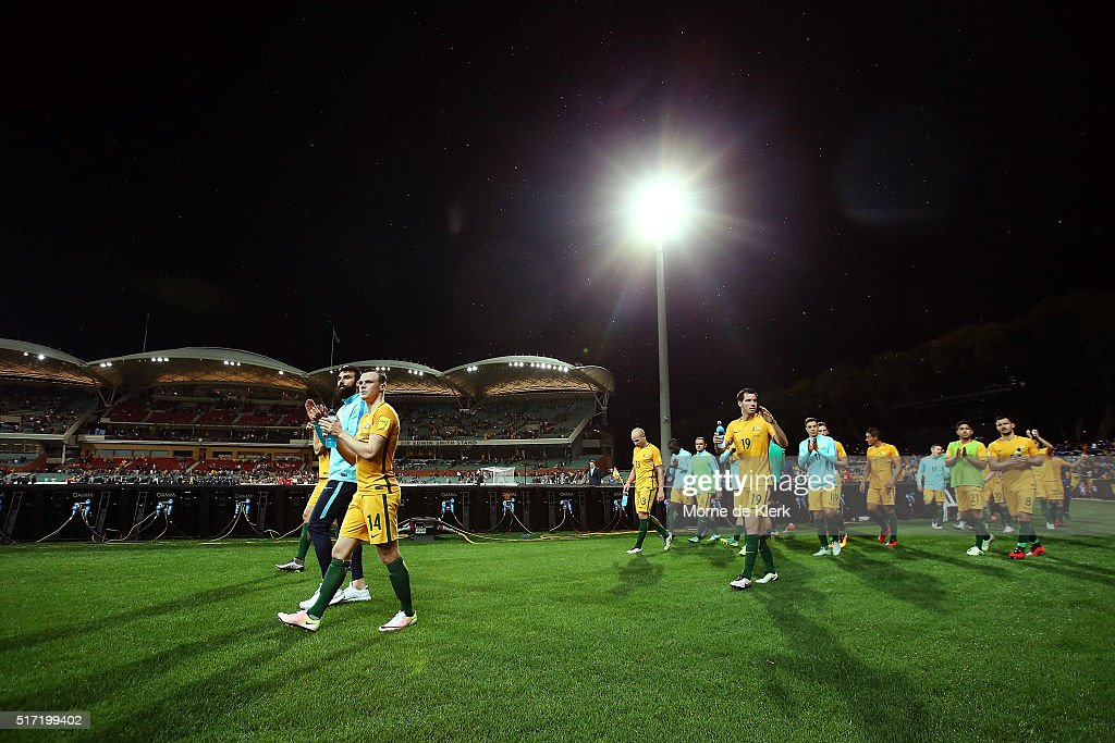 Australian players complete a lap after the 2018 FIFA World Cup Qualification match between the Australia Socceroos and Tajikistan at the Adelaide Oval on March 24, 2016 in Adelaide, Australia.