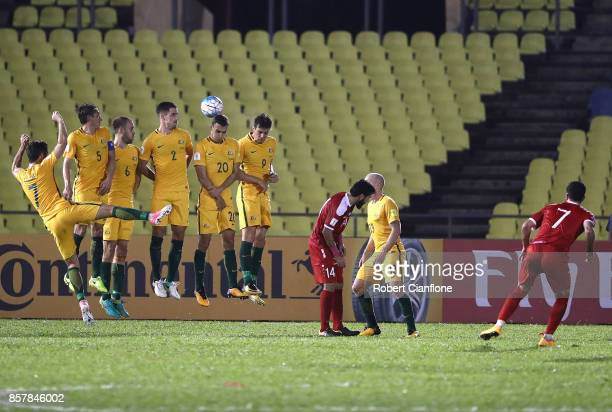 Australian players defend a free kick from Omar Khrbin of Syria during the 2018 FIFA World Cup Asian Playoff match between Syria and the Australia...