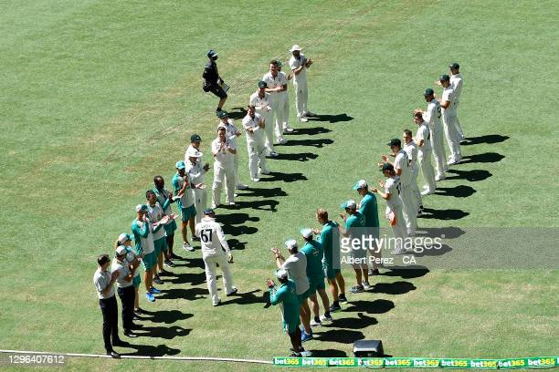 Australian players form a guard of honour for Nathan Lyon to celebrate his 100th test match during day one of the 4th Test Match in the series...