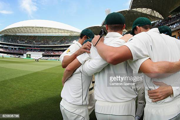 Australian players huddle during day three of the Third Test match between Australia and South Africa at Adelaide Oval on November 26 2016 in...