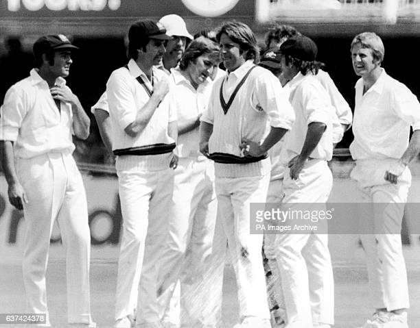 Australian players including fellow bowlers Jeff Thomson and Dennis Lillee congratulate Gary Gilmour on one of his five wickets