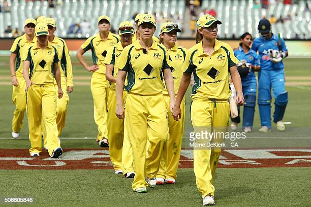 Australian players leave the field after the women's Twenty20 International match between Australia and India at Adelaide Oval on January 26, 2016 in...