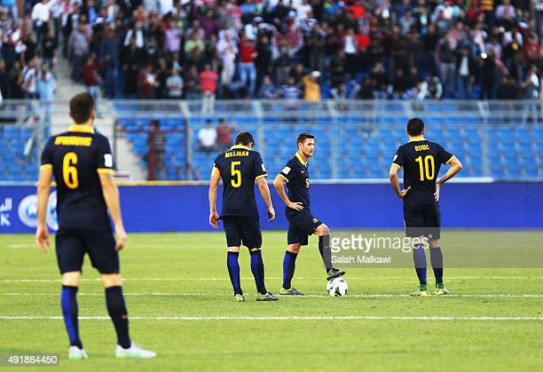 Australian players look dejected during the 2018 FIFA World Cup qualification match between Jordan and Australia Socceroos at Amman International...