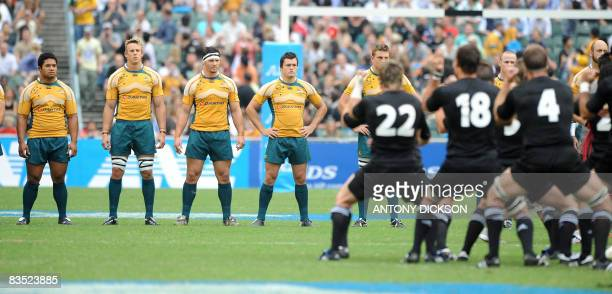 """Australian players observe New Zealand players performing a pre-game """"haka"""" before the start of the Bledisloe Cup in Hong Kong on November 1, 2008...."""