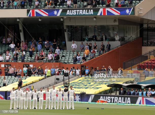 Australian players pause during day one of the First Test match between Australia and India at Adelaide Oval on December 17, 2020 in Adelaide,...