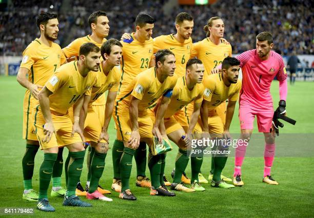 Australian players pose for photographers before group B World Cup 2018 qualifying football match between Japan and Australia in Saitama on August 31...