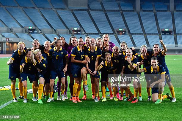 Australian players pose for photographs after their qualification for the Rio de Janeiro Olympics after their 21 win in the AFC Women's Olympic Final...