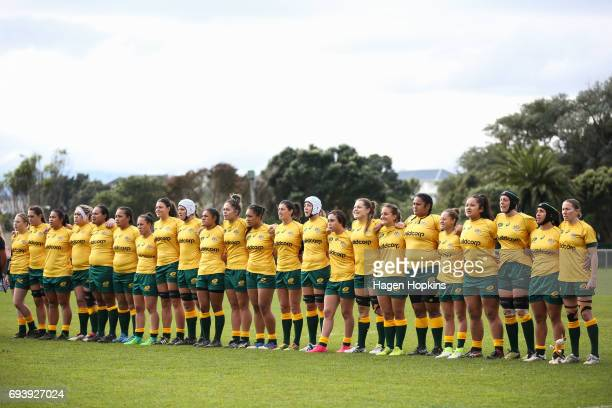 Australian players sing the national anthem during the Women's International Test match between the Australian Wallaroos and the England Roses at...
