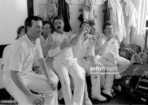 Australian players Steve Waugh Dean Jones David Boon Geoff Marsh Mark Taylor and Allan Border celebrate in their dressing room after winning the 1st...