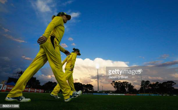 Australian players take the field during the Women's One Day International match between Australia and England on October 26 2017 in Coffs Harbour...