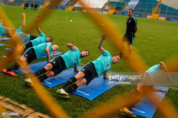 Australian players Tim Cahill Aaron Mooy Milos Degenek and Dylan McGowan exercise during a training session at Francisco Morazan stadium in San Pedro...