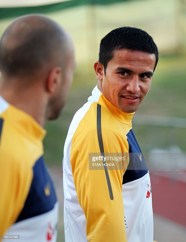 Australian players Tim Cahill (R) and Mark Bresciano (L) arrive for a team training session at Ruimsig Stadium in Roodepoort on June 16, 2010 during the 2010 World Cup football tournament. Cahill will learn on June 17 if he is to receive a one or two-match suspension for his red card against Germany. AFP PHOTO/Stan Honda